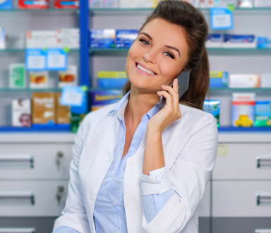 pharmacist talking someone on the phone