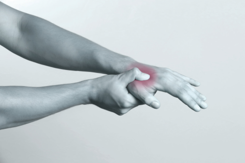 acute pain in a man hand